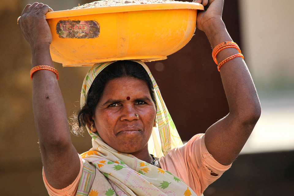 Indian Woman Carrying Grain